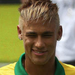 Neymar smiling and wearing the Brazil jersey